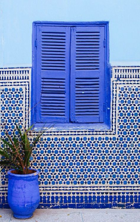 blue wall and window with patterns