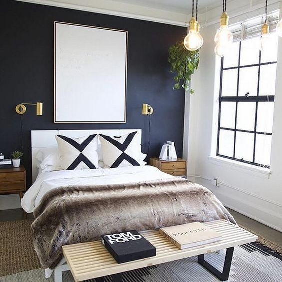 bedroom with dark blue wall