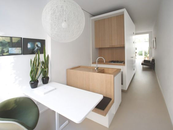 small apartment with seat and ktichen