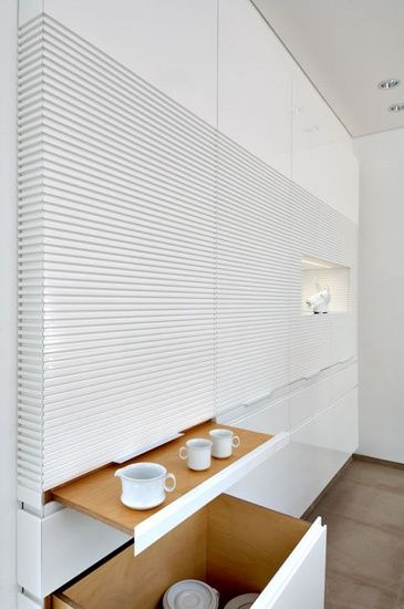 white kitchen cabinet with concealed storage