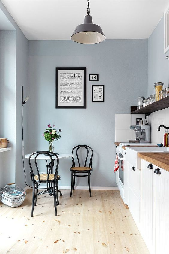 blue dining room with white table