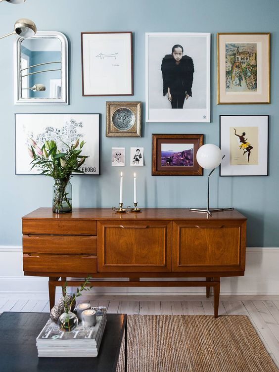 blue living room with wooden table
