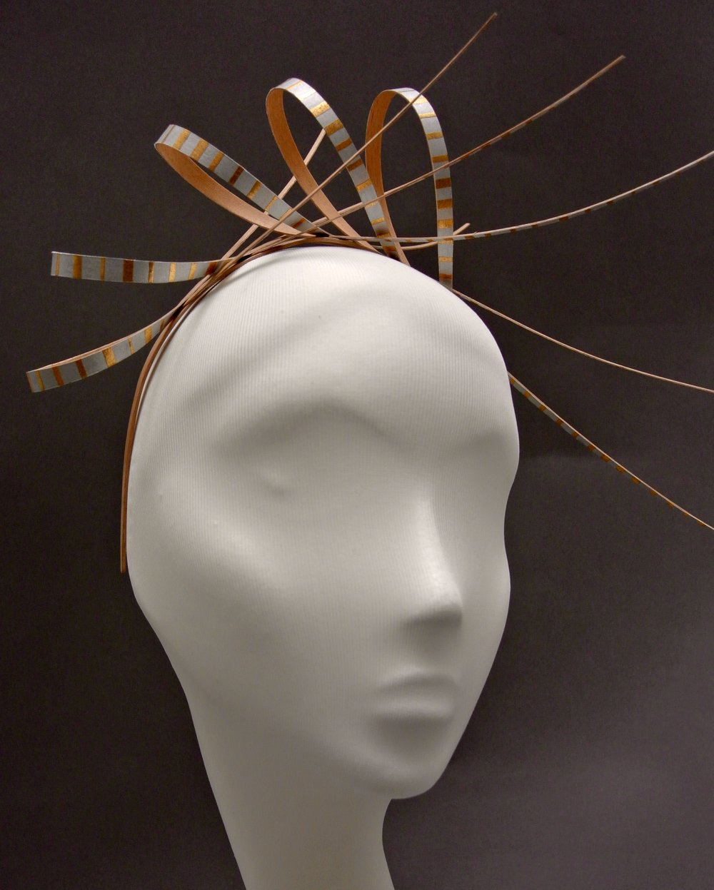 Liberty; laminated beech headband with paper covered beech loops and aluminium rivets