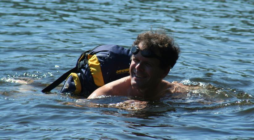 Peter Hayes swimming in Ullswater with swimsac