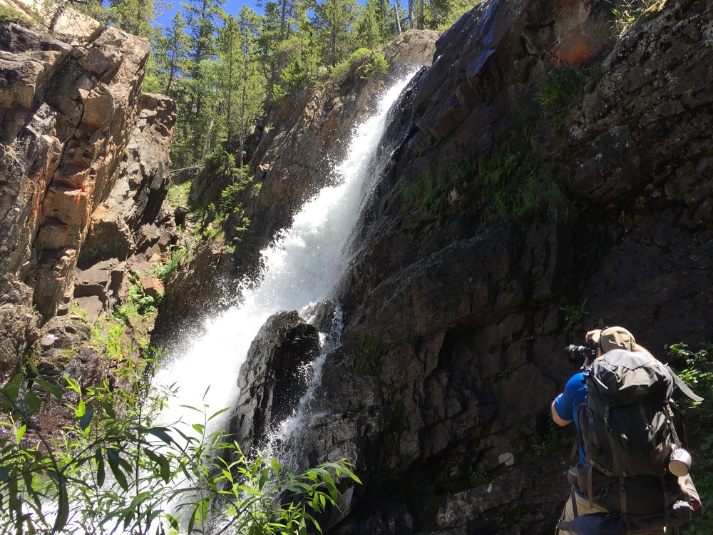 The man behind Break Trail (Ryan) getting an up-close  photograph of a waterfall