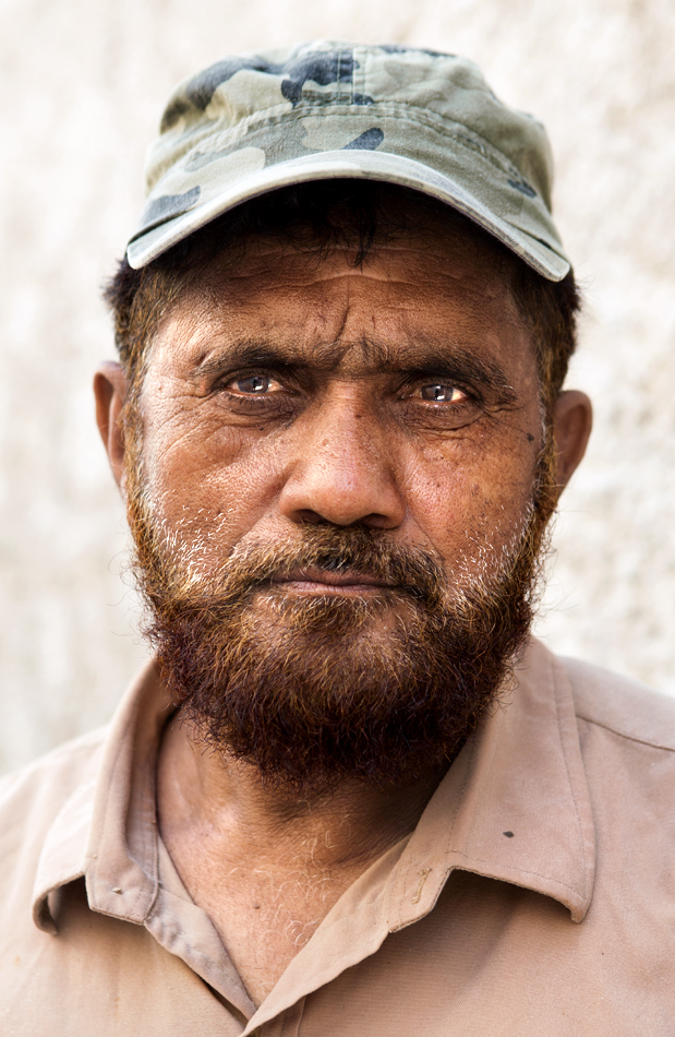 Pakistani construction worker profile portrait. Cinematic middle eastern arabic street portrait photography. Daniel Allison photography.