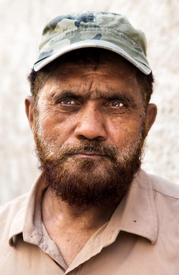 Pakistani construction worker profile portrait. Cinematic middle eastern arabic street portrait photography. Daniel Allison photography.