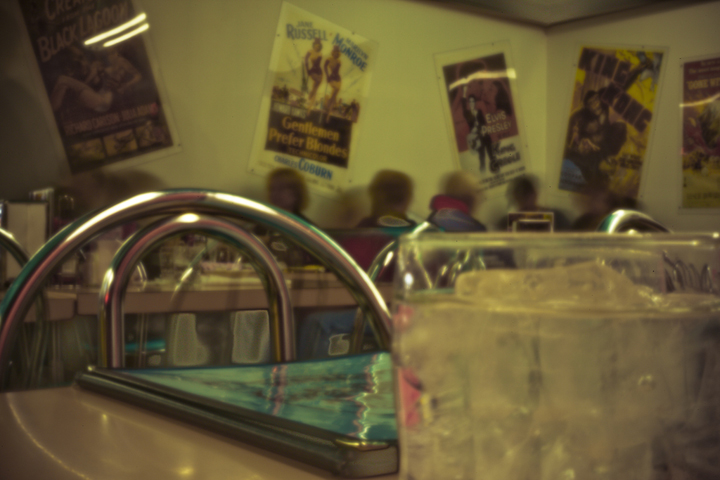 Digital pinhole of 50's style restaurant in Great Falls Montana with vintage horror movie posters on the wall.