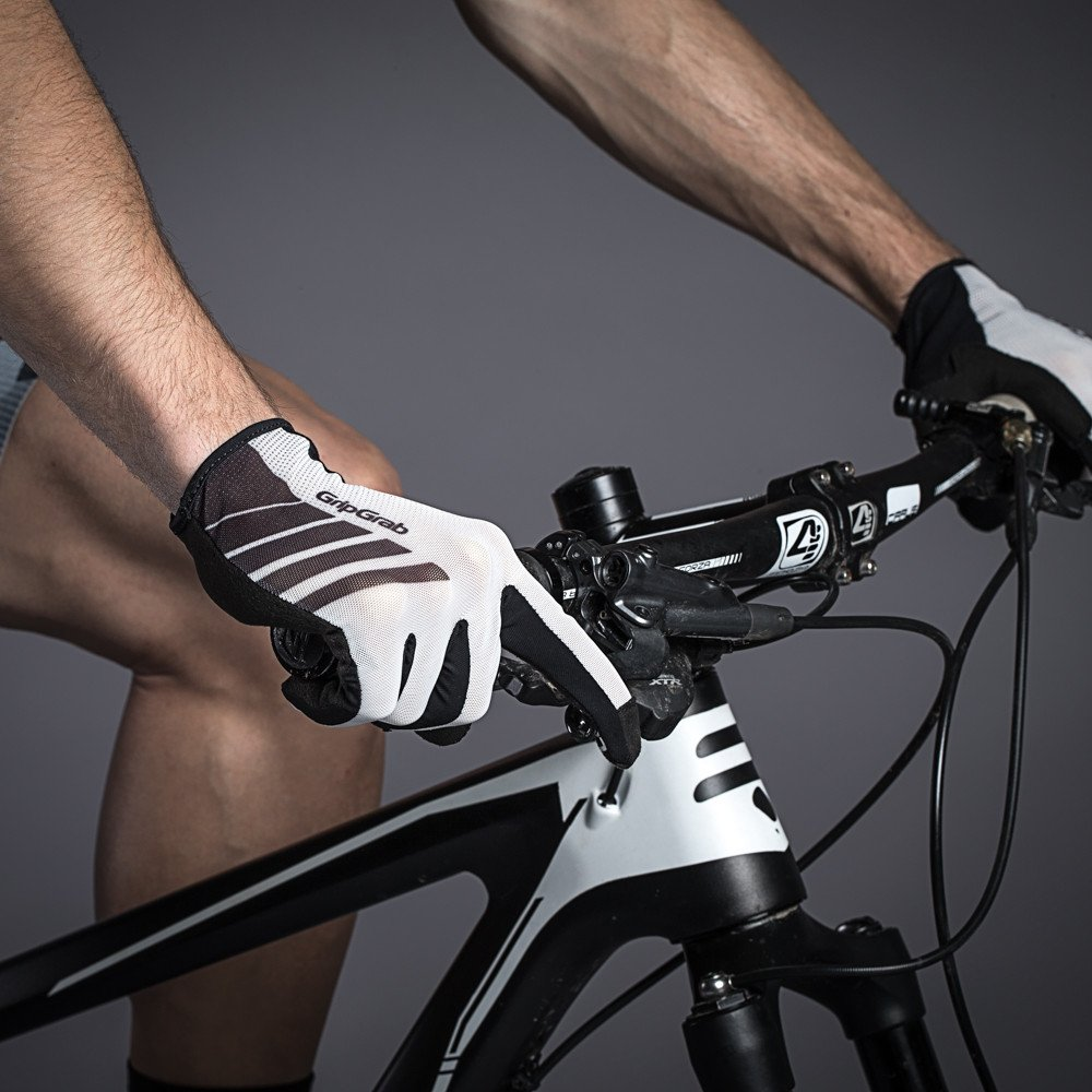 The Racing  - The Racing is a pro level performance mountain bike glove, with the ingenious InsideGrip technology that delivers an unforeseen level of handlebar control.