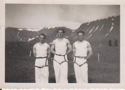 Sports-club members in wrestling costume