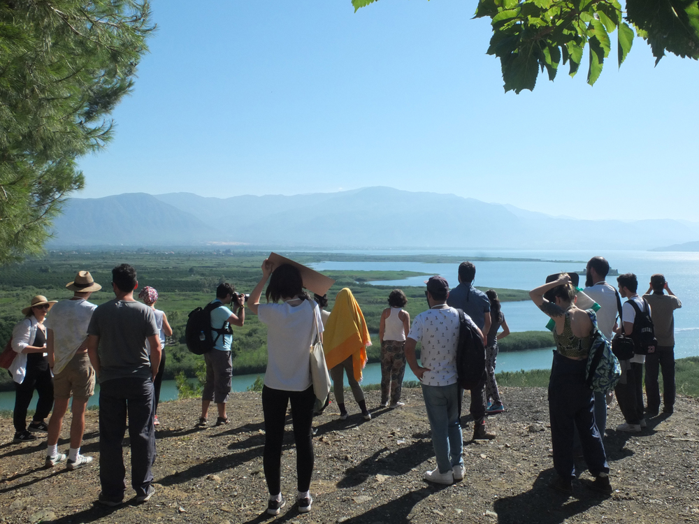 The group looks over Köyceğiz lake. The vast expanse of agricultural land to the left was a huge Liquidambar forest 150 years ago, before it was felled to make way for citrus & pomegranate groves.