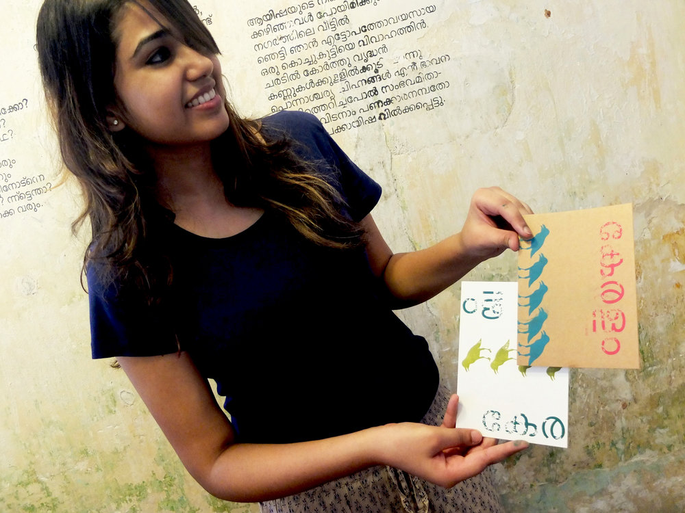 Shruthi against the Malayalam mugshot wall!