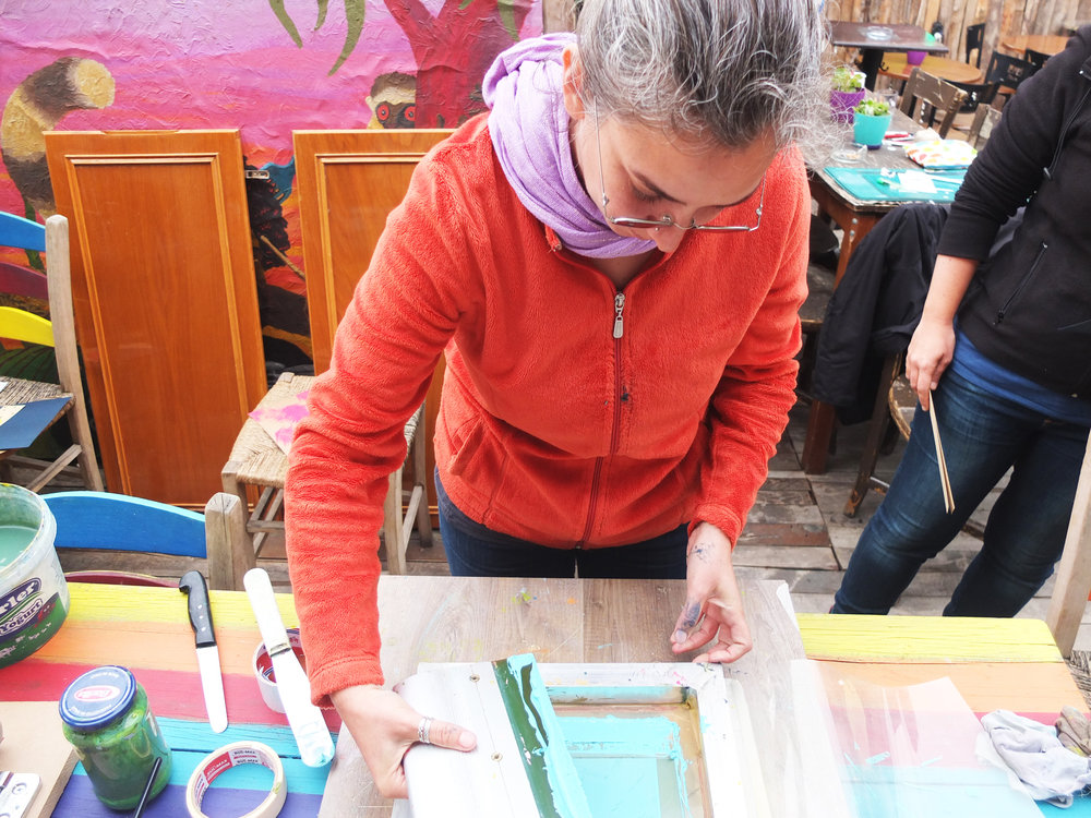 Leyla getting to grips with silkscreen printing....