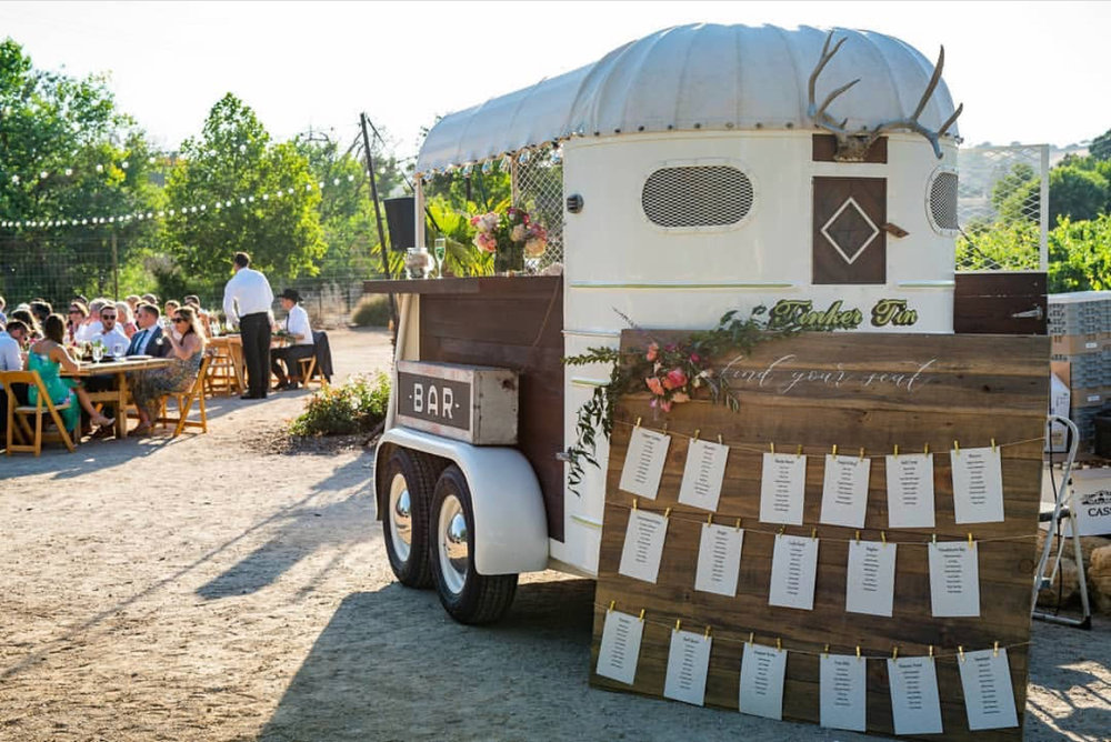 We loved how well this bohemian/rustic escort display accented our 1948 Trailer King mobile horse trailer bar at this Cass Winery wedding in Paso Robles, Ca.