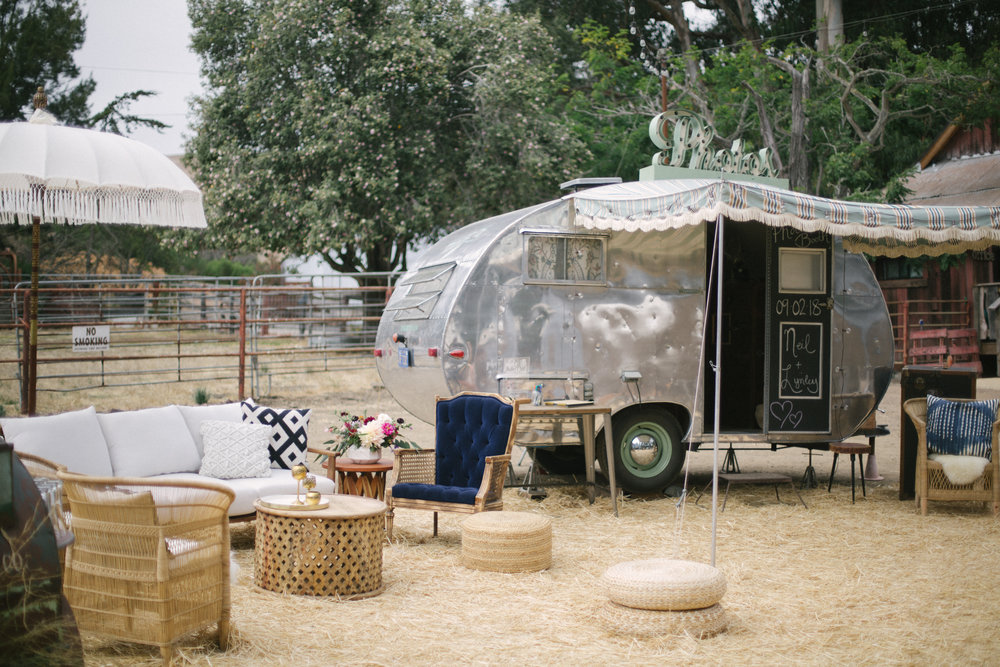Boho wedding lounge and photobooth trailer