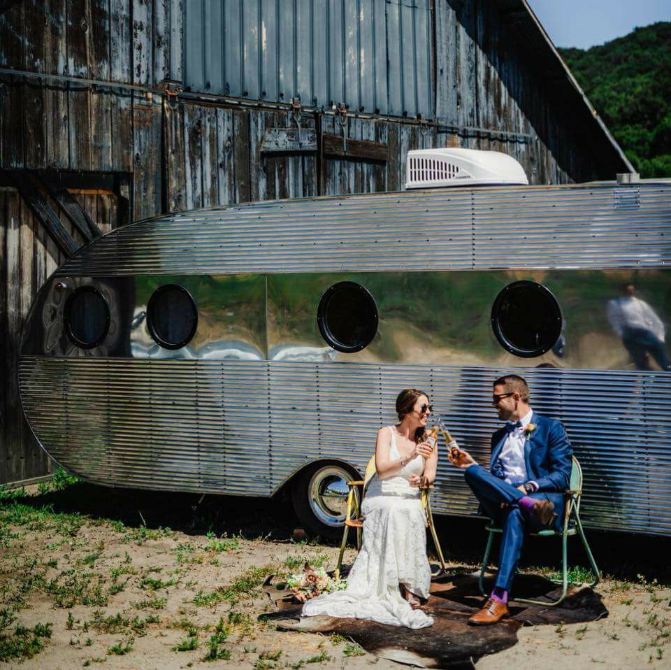 Our 1948 Airfloat vintage trailer comes equipped with air-conditioning, a queen sized bed, lounge and kitchen. It is the perfect trailer rental for a bridal suite, groom's lounge, VIP lounge and more!
