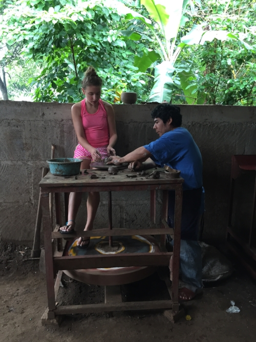 Pasquel helping Scout Make Pottery
