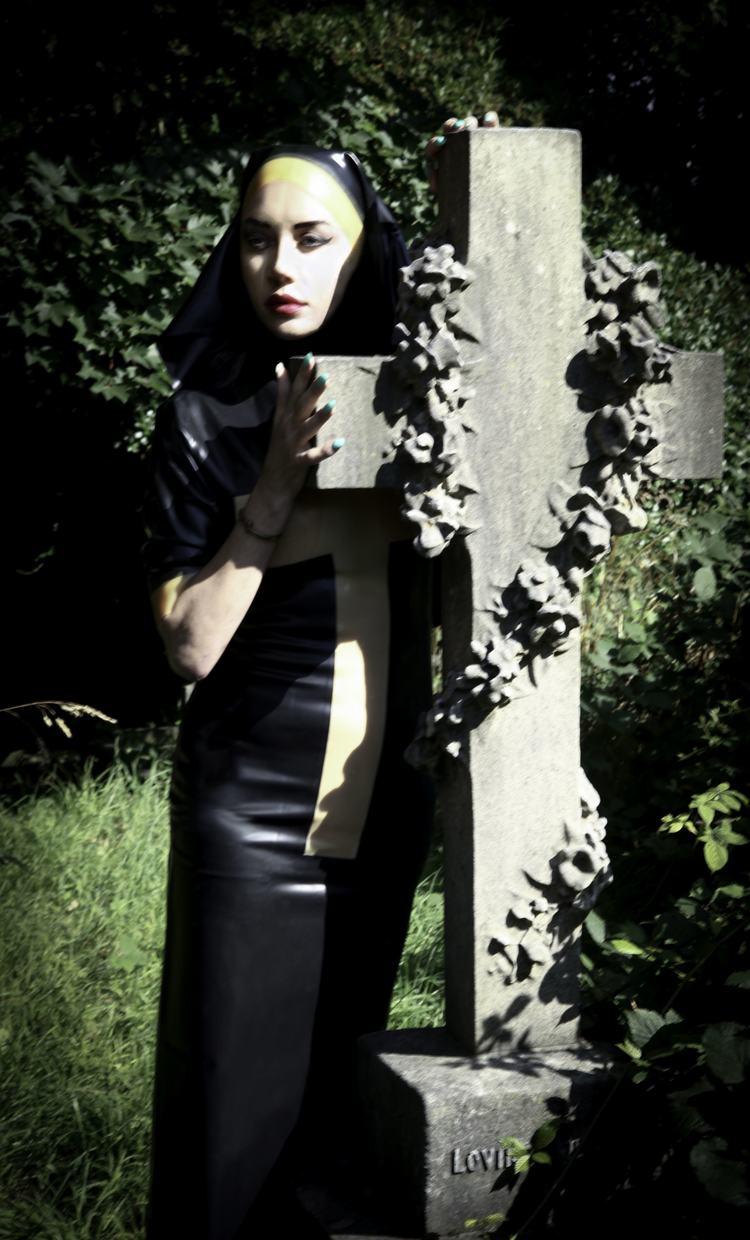 Nun by the Stone Crucifix