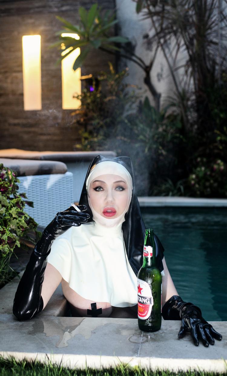 Nun Smokes in Pool