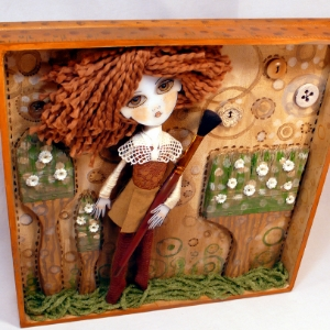 Doll collage in box