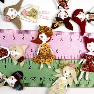 Mini collage dolls