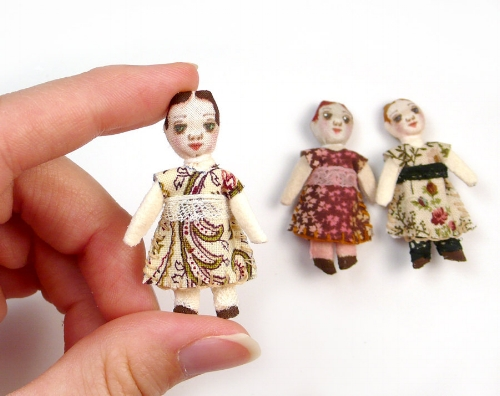 These dolls are made using tiny faces I designed and added to Spoonflower so you can print them on demand. One $5 swatch holds 25 tiny faces! That's a lot of tiny dolls. Available as  grumpy and happy ragdolls  or  antique dolls and animals .