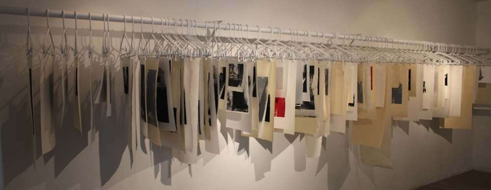 (De)Constructing Memory   Serigraphs on paper and mylar, hangers, closet rod  2011