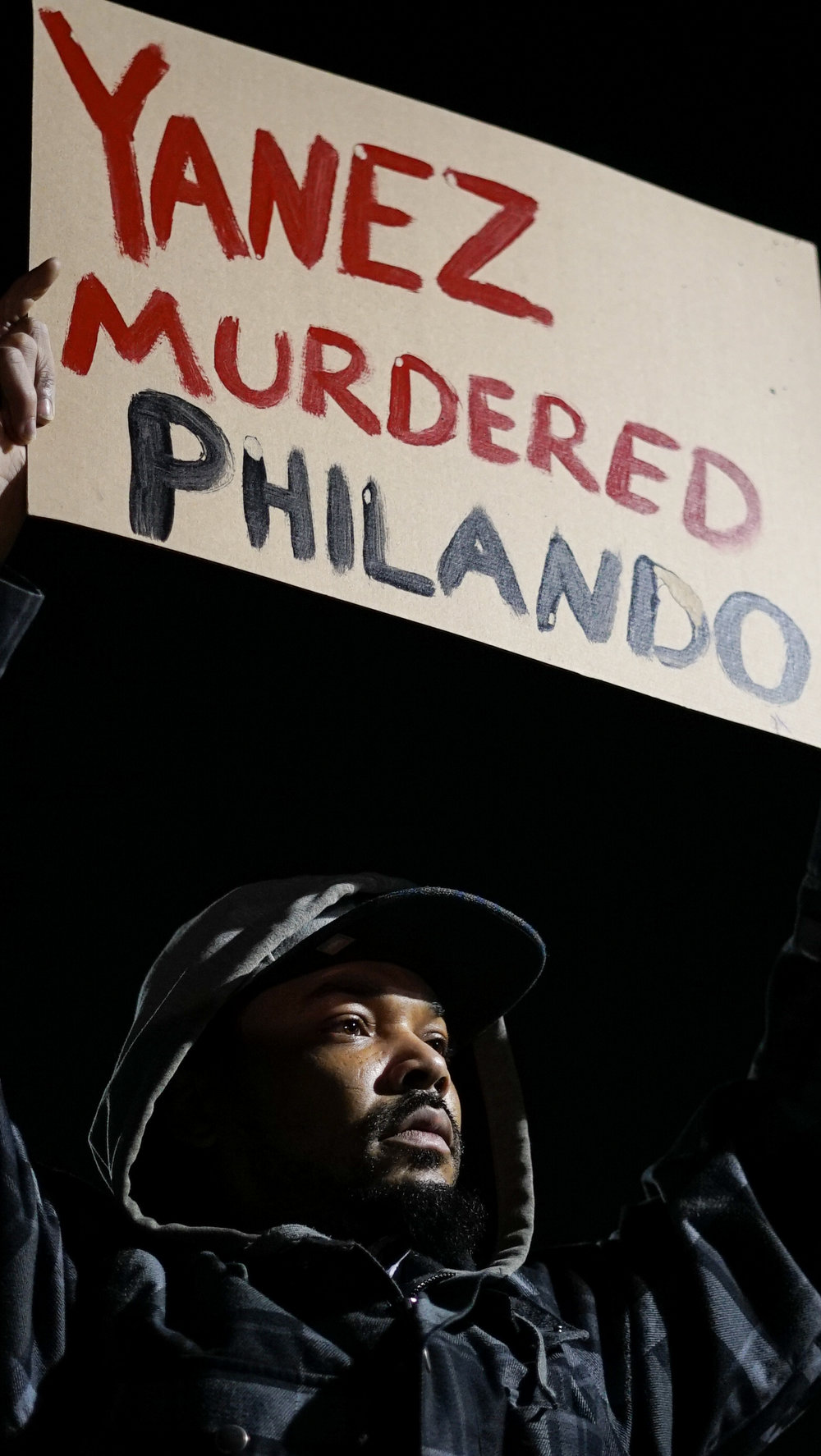 """Darius Taylor, a childhood friend of Philando Castile, said he """"was a good brother who didn't deserve that,"""" at a rally Wednesday, Nov. 16, 2016, to celebrate charges filed against the officer who shot and killed Castile."""