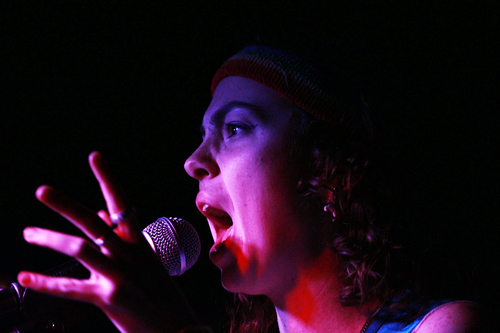 Bailey Cogan, lead singer and song writer for 26 Bats!, belts the trademark social statement lyrics not at the nodding crowd at Honey (Minneapolis), but rather, is singing for them.