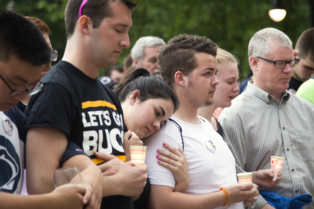 State College community came together for a candle vigil honoring those lost in the Orlando shooting in June 2016 at Penn State's Old Main lawn.