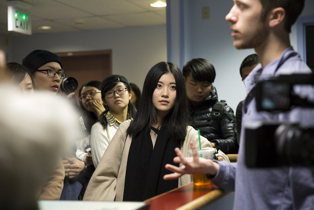 Students of Shanghai International Studies University's global reporting program visited Penn State's Daily Collegian on November 6, 2016. Xuyi Chen, middle, listened to an introduction from Garret Ross, editor-in-chief of the paper.