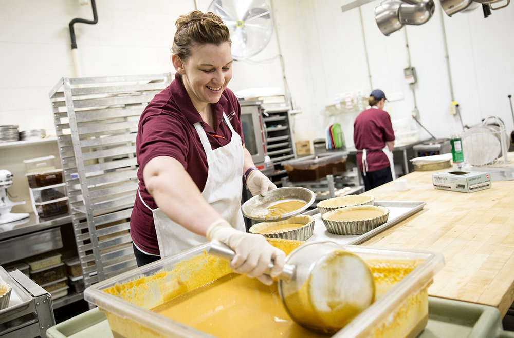 Jessica DeHaas, a bakery assistant at the Penn State Bakery, prepared Thanksgiving pumpkin pies for the Nittany Lion Inn.