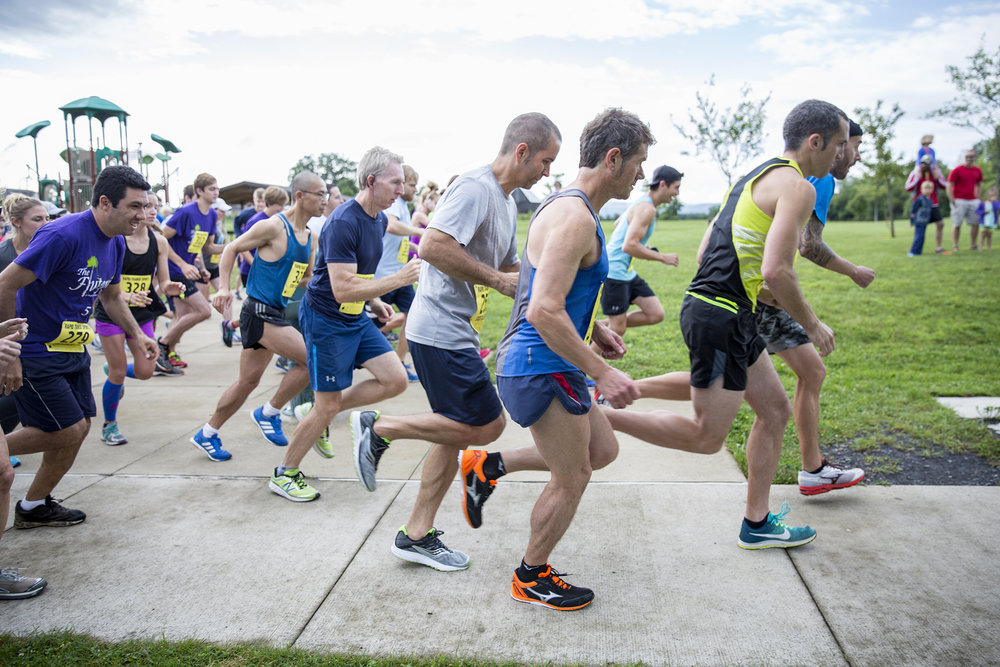 Runners, joggers and walkers join the 4th Annual Flutopia 5k in Tom Tudek Memorial Park, State College on July 29, 2017. The race benefits Centre Volunteers in Medicine and Doctors Without Borders.