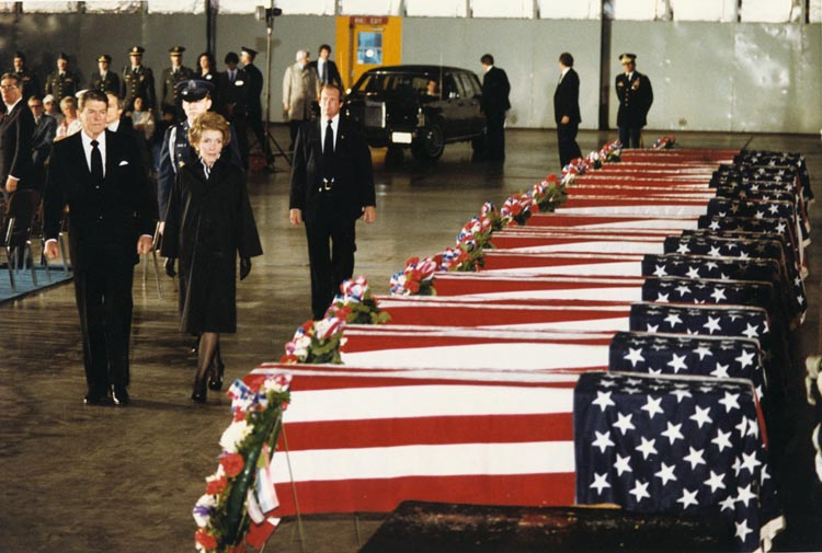 President Ronald Reagan and First Lady Nancy Reagan pay their respects to the caskets of the 17 US victims of the 1983 attack on the United States Embassy in Beirut during the last conjunction of Saturn/Pluto. Image courtesy of the Reagan Library, via Wikimedia Commons.