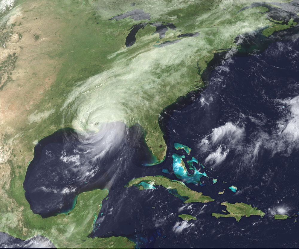A view of Hurricane Katrina over Louisiana and Mississippi on August 29, 2005 during the beginning stages of the Saturn/Neptune opposition; image from the NASA Earth Observatory website, via Wikimedia Commons.