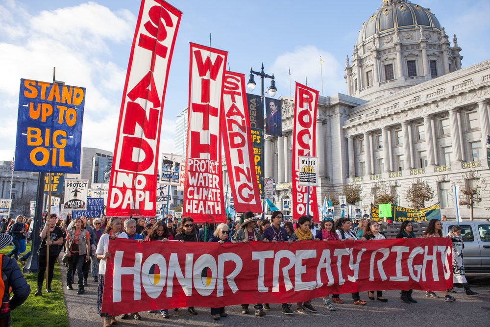 People marching to protest the Dakota Access Pipeline near San Francisco City Hall; photo by Pax Ahimsa Gethen. By Pax Ahimsa Gethen (Own work) [CC BY-SA 4.0 (http://creativecommons.org/licenses/by-sa/4.0)], via Wikimedia Commons