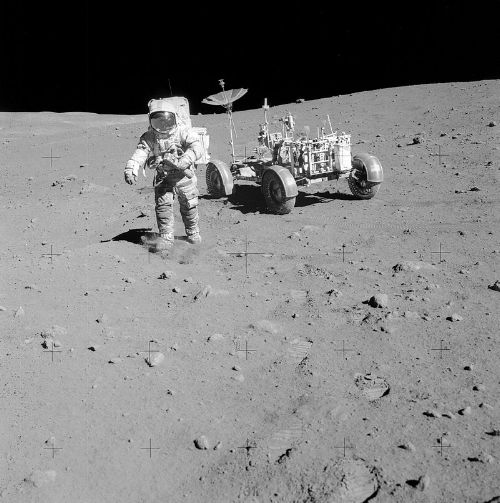 Dave Scott on the rim of Hadley Rille at Station 10 during the Apollo 15 mission; photo by  NASA .