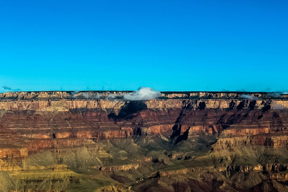 Lone cloud at Grand Canyon South Rim; photo by Chad Woodward, 2018