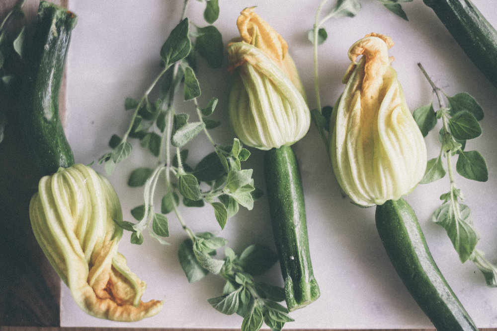 oven roasted ricotta, tomato and pine nut stuffed zucchini flowers www.derrive.com