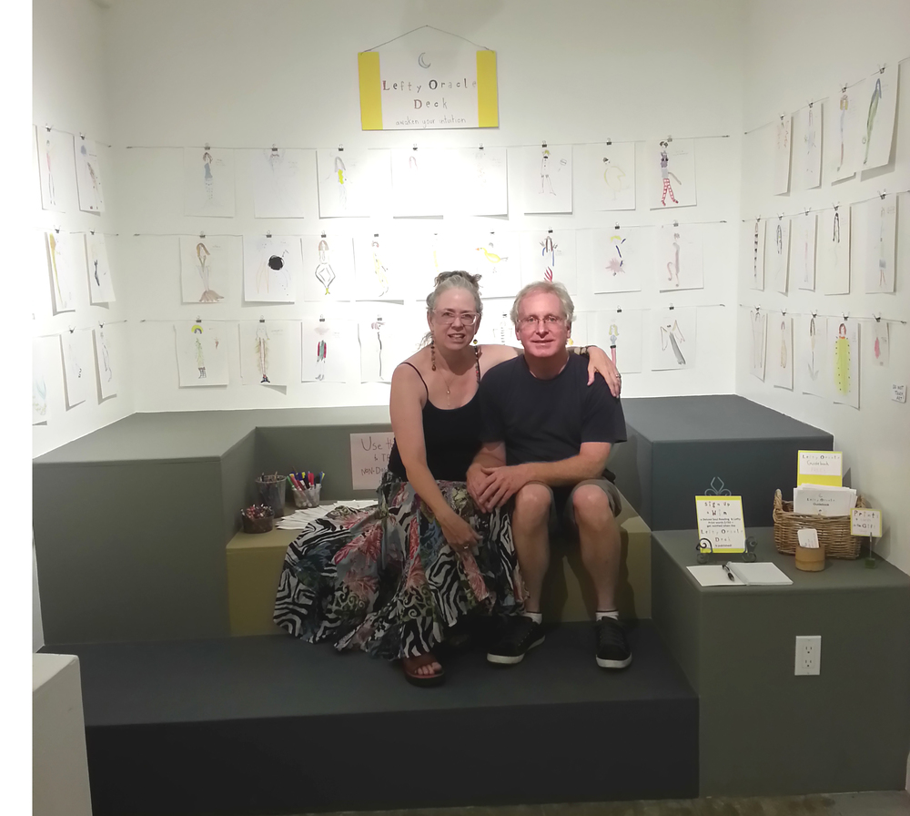Me and my amazIng husband Mark who helped me design and install my lefty oracle paintings at Riverside Art Museum.