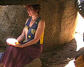Kathy meditating in a cave in Sage, California