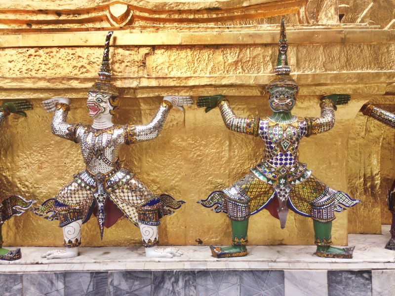Figures surrounding a spire at Wat Phra Kaew