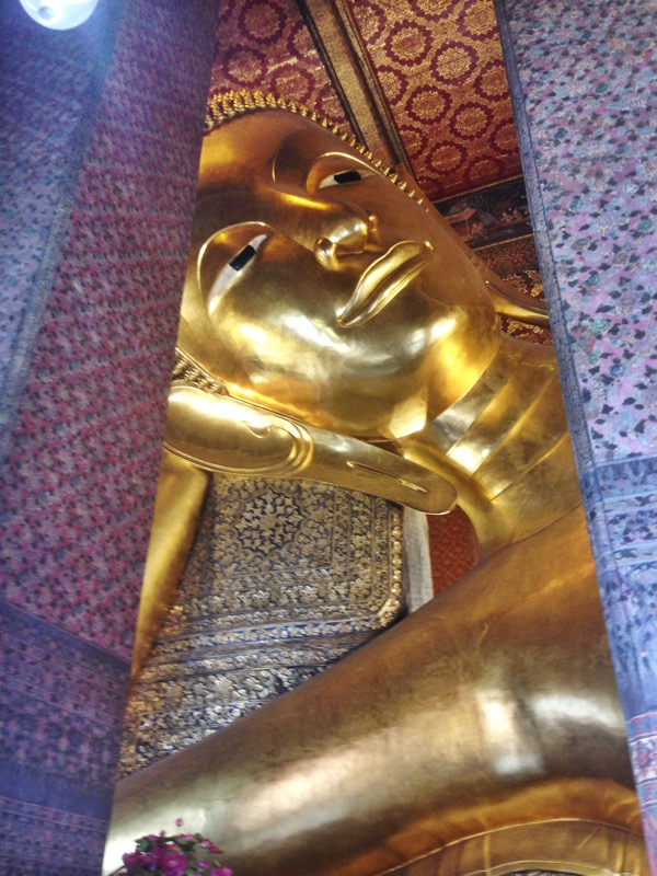Looking up at the head of the reclining buddha (it continues for the length of a full body)
