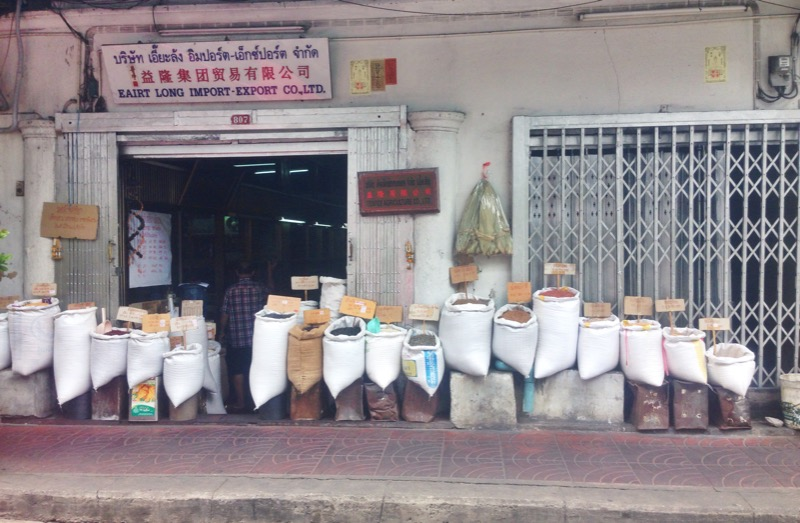 Bags of fresh spices on the outside sidewalk of Chinatown