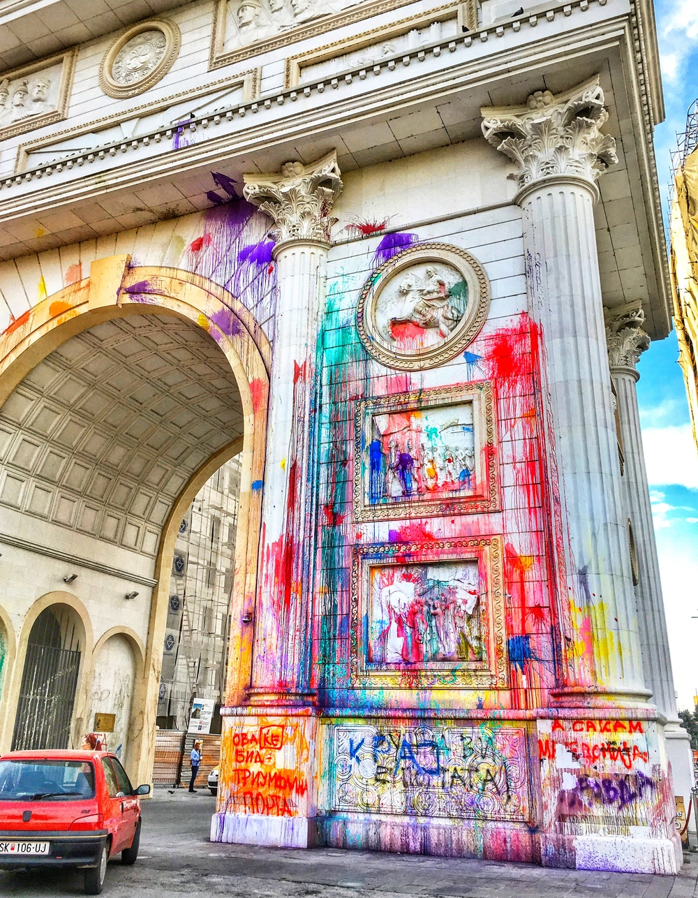 Skopje's arc de triumph covered in exploded paint balloons
