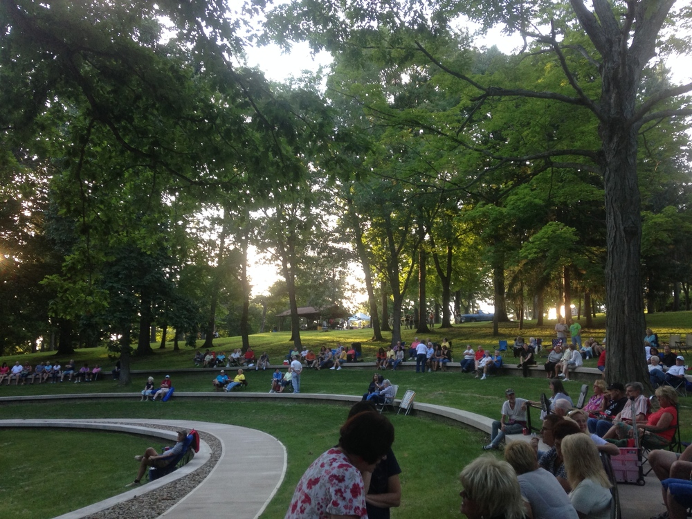 A crowd enjoys a summer performance at the amphitheater