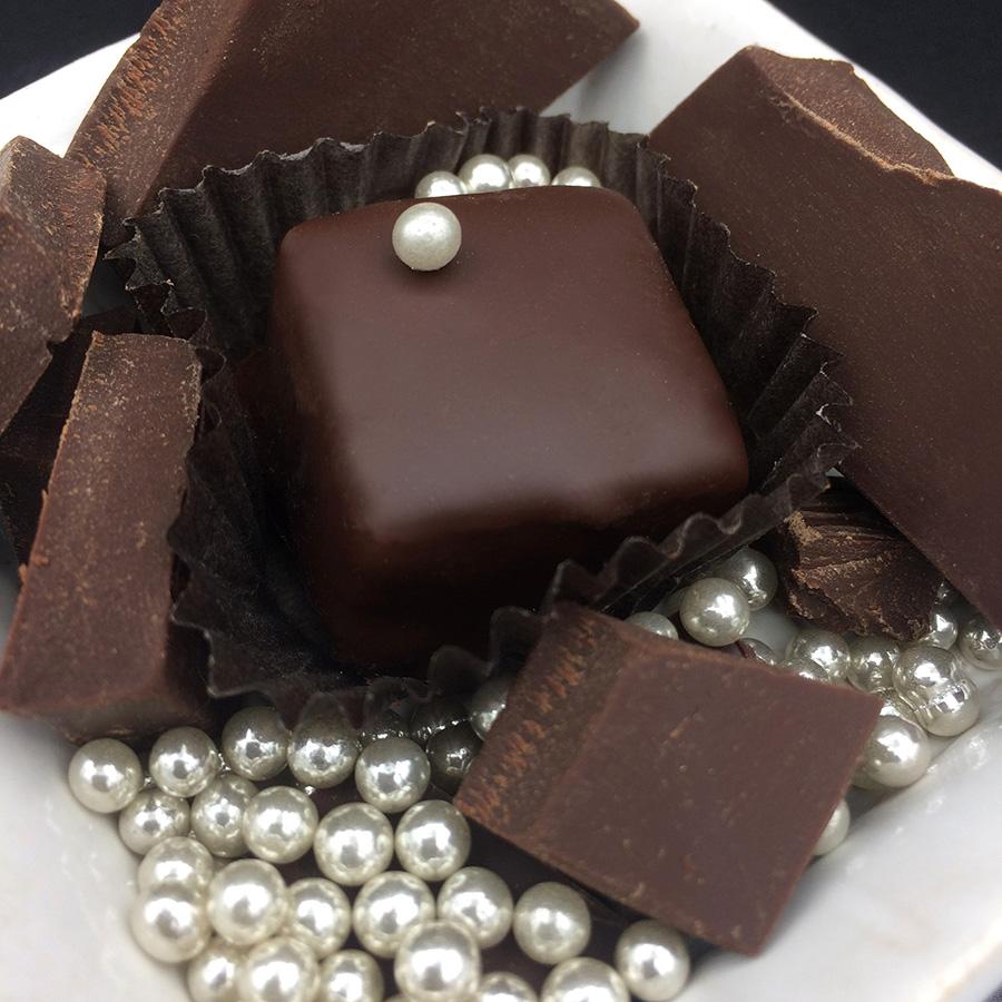 THE CHASTE  PURE DARK CHOCOLATE TRUFFLE 70% dark organic fair trade chocolate, organic heavy cream, organic butter, organic cane sugar, organic vanilla, sugar pearl