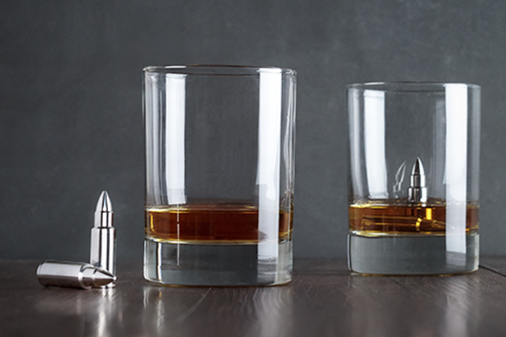 Stainless Steel Bullet Whiskey Rocks When it comes to chilled libations, these stainless steel bullet whiskey rocks are the sharpest shooters in the industry, keeping liquor cooler and less diluted than traditional ice accessories. Pour spirits on the rocks for a stone-cold killer taste.