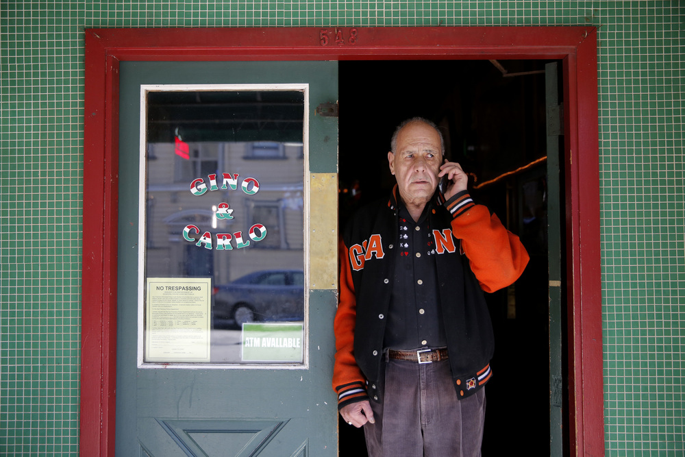 Silvio Maniscalco talks to his daughter on the phone outside Gino & Carlo where he works as a bartender in San Francisco, California, on Thursday, Aug. 13, 2015.