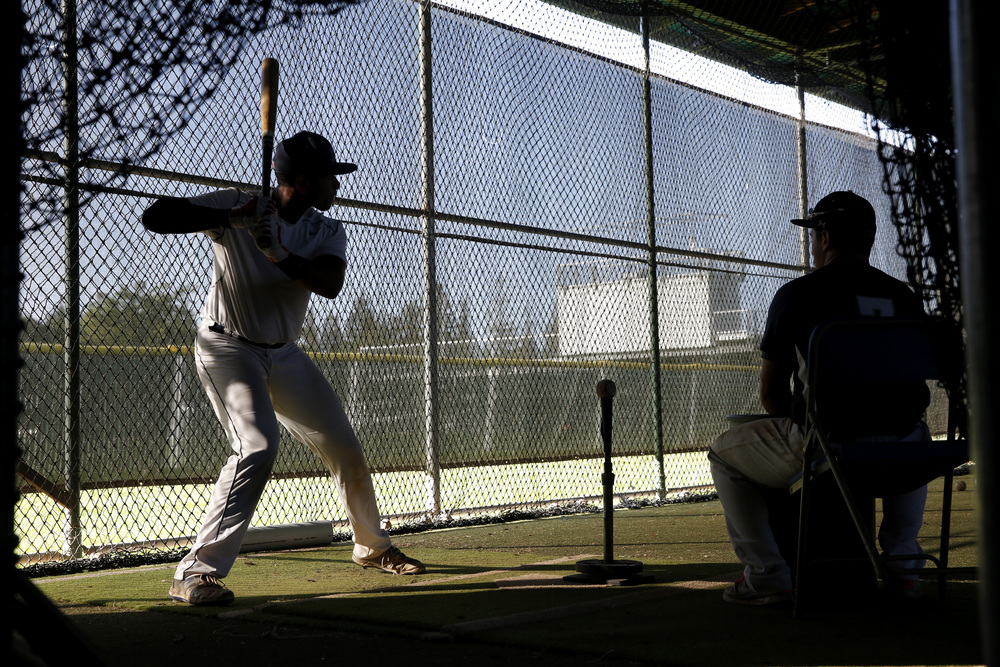 Two Menlo College baseball players take batting practice after a home game in Atherton, California, on Wednesday, March 30, 2016.